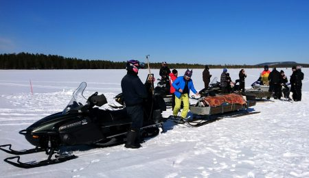 Winter fishing trip on the Arctic Circle Lake Miekojärvi